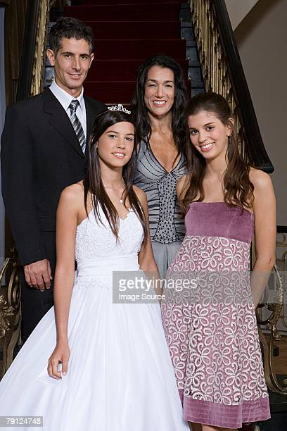 Quinceanera with her family
