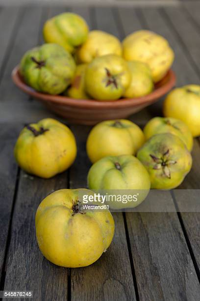 Quinces, Cydonia oblonga, on dark wood