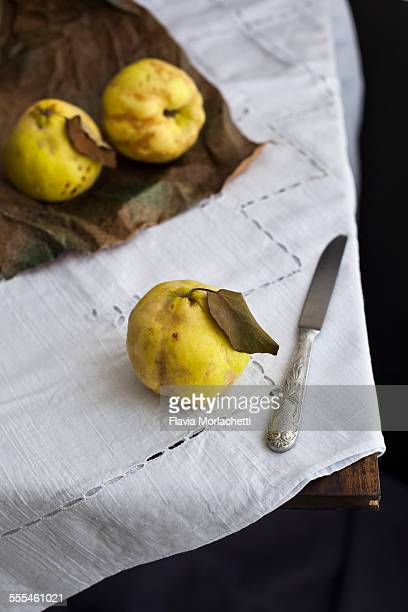 Quinces on table