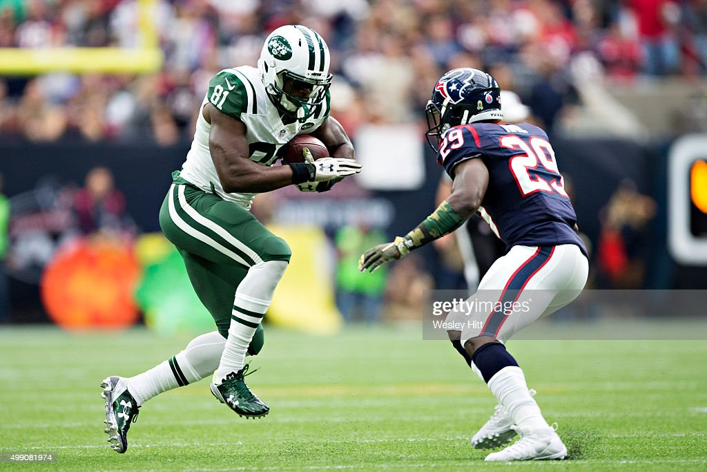Quincey Enunwa #81 of the New York Jets runs the ball and tries to avoid the tackle of <a gi-track='captionPersonalityLinkClicked' href=/galleries/search?phrase=Andre+Hal&family=editorial&specificpeople=8281332 ng-click='$event.stopPropagation()'>Andre Hal</a> #29 of the Houston Texans at NRG Stadium on November 22, 2015 in Houston, Texas. The Texans defeated the Jets 24-17.