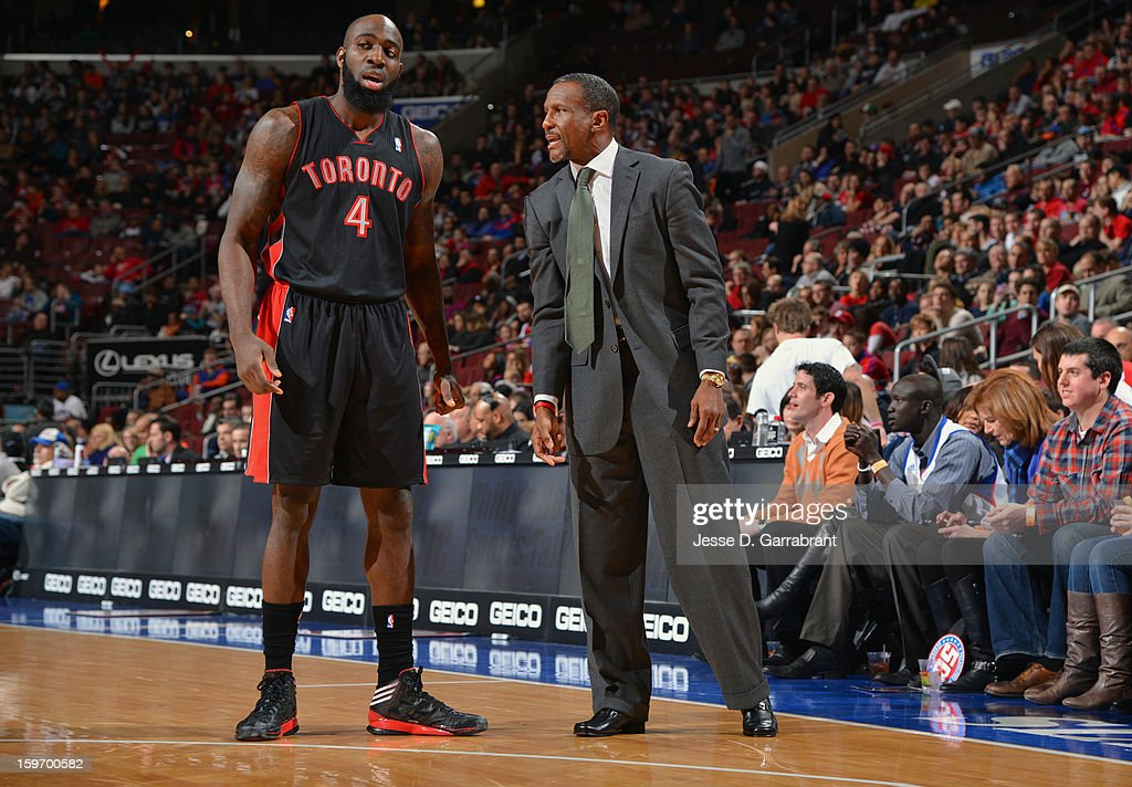 Quincy Acy #4 and Head Coach Dwane Casey of the Toronto Raptors during the game against the Philadelphia 76ers at the Wells Fargo Center on January 18, 2013 in Philadelphia, Pennsylvania.