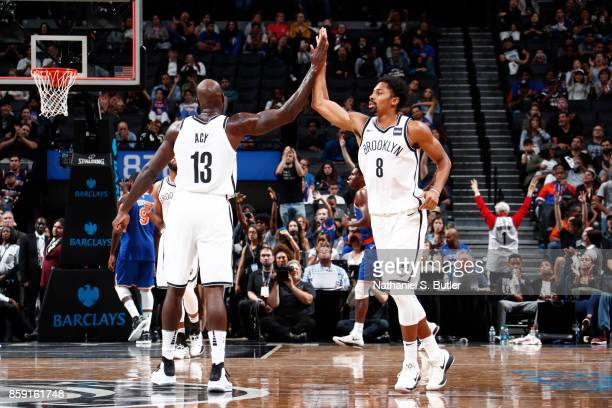 Quincy Acy and Spencer Dinwiddie of the Brooklyn Nets high five during a preseason game against the New York Knicks on October 8 2017 at Barclays...