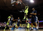 Quincy Acy of the Baylor Bears dunks against the Xavier Musketeers in the first half during the 2012 NCAA Men's Basketball South Regional Semifinal...