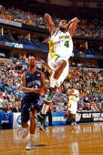 Quincy Acy of the Baylor Bears dunks the ball over Keyon Carter of the Old Dominion University Monarchs during the second round of the 2010 NCAA...