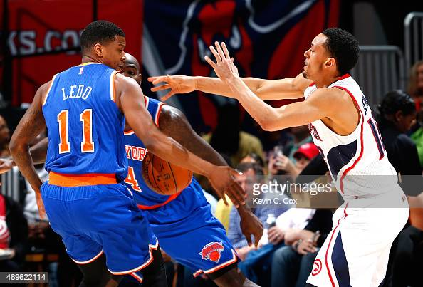 Quincy Acy of the New York Knicks defends as John Jenkins of the Atlanta Hawks passes the ball into the arms of Ricky Ledo at Philips Arena on April...