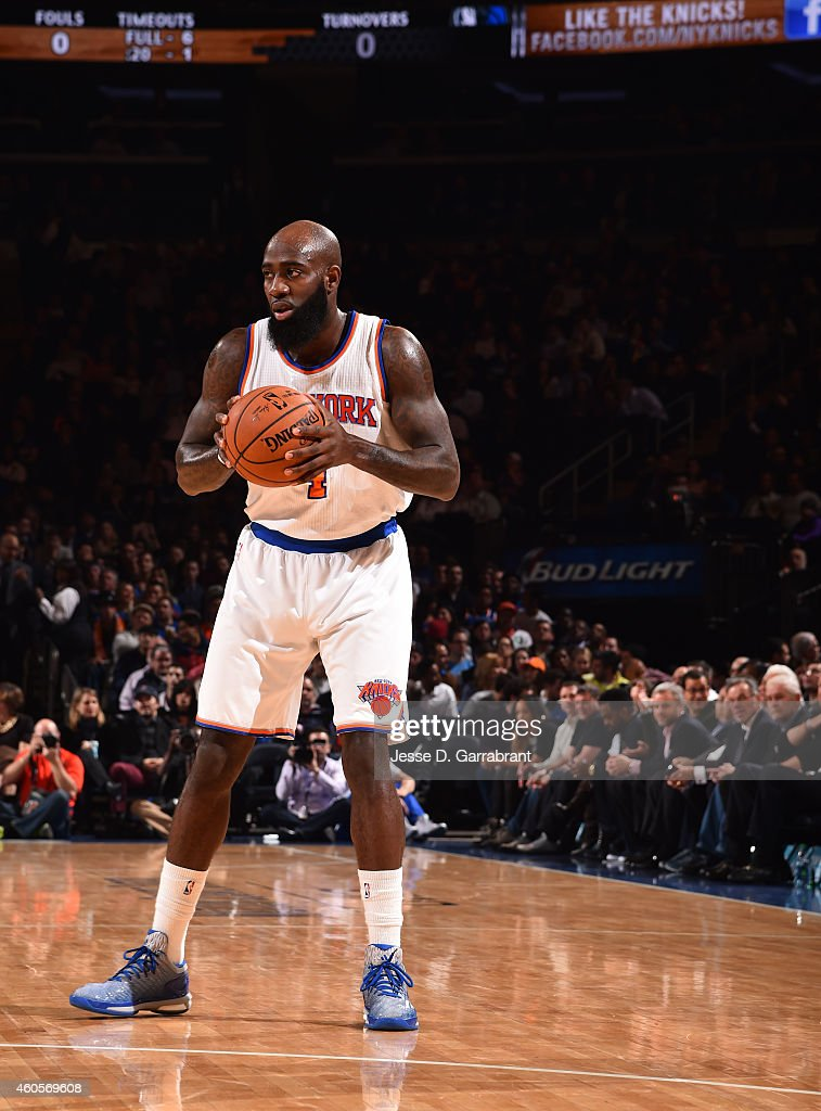 Quincy Acy #4 of the New York Knicks looks to pass the ball against the Dallas Mavericks on December 16, 2014 at Madison Square Garden in New York, NY.