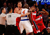 Quincy Acy of the New York Knicks scuffle with John Wall of the Washington Wizards in the second half of their game at Madison Square Garden on...