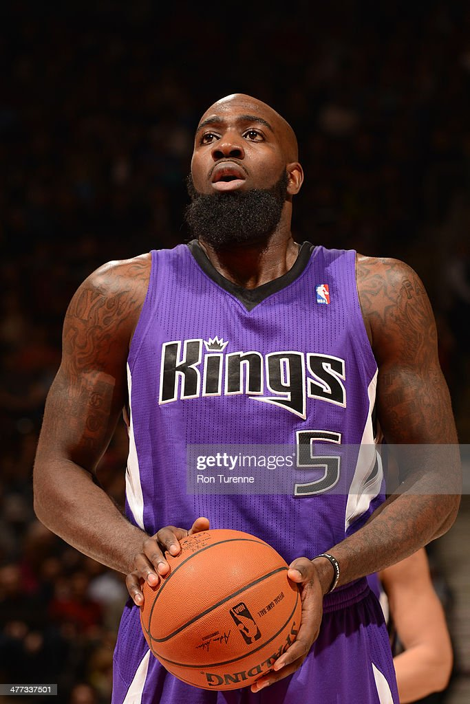 <a gi-track='captionPersonalityLinkClicked' href=/galleries/search?phrase=Quincy+Acy&family=editorial&specificpeople=5674079 ng-click='$event.stopPropagation()'>Quincy Acy</a> #5 of the Sacramento Kings attempts a free throw against the Toronto Raptors on March 7, 2014 at the Air Canada Centre in Toronto, Ontario, Canada.