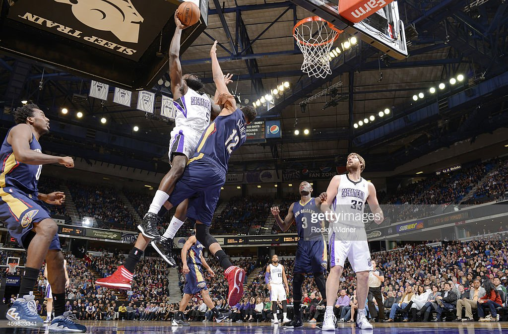 <a gi-track='captionPersonalityLinkClicked' href=/galleries/search?phrase=Quincy+Acy&family=editorial&specificpeople=5674079 ng-click='$event.stopPropagation()'>Quincy Acy</a> #5 of the Sacramento Kings goes up for the shot against the New Orleans Pelicans on December 23, 2013 at Sleep Train Arena in Sacramento, California.