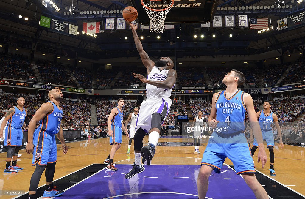 <a gi-track='captionPersonalityLinkClicked' href=/galleries/search?phrase=Quincy+Acy&family=editorial&specificpeople=5674079 ng-click='$event.stopPropagation()'>Quincy Acy</a> #5 of the Sacramento Kings rebounds against the Oklahoma City Thunder on April 8, 2014 at Sleep Train Arena in Sacramento, California.