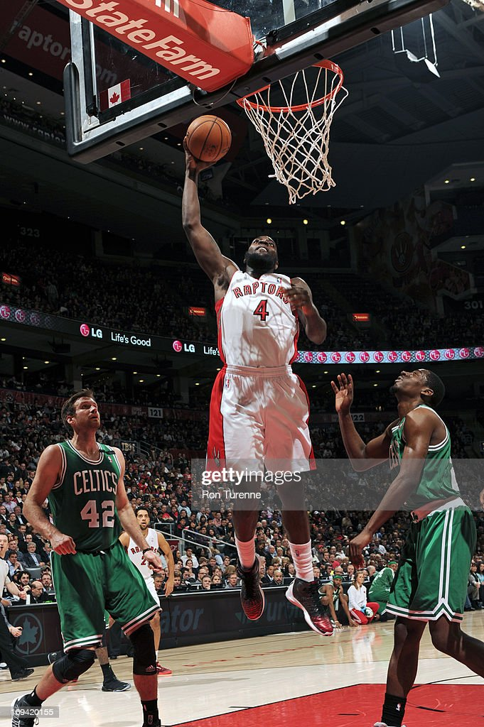 Quincy Acy #4 of the Toronto Raptors drives to the basket against the Boston Celtics on April 17, 2013 at the Air Canada Centre in Toronto, Ontario, Canada.