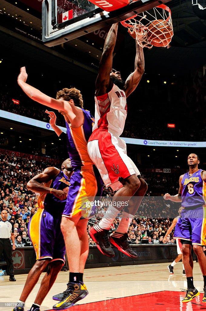 Quincy Acy #4 of the Toronto Raptors dunks against the Los Angeles Lakers on January 20, 2013 at the Air Canada Centre in Toronto, Ontario, Canada.
