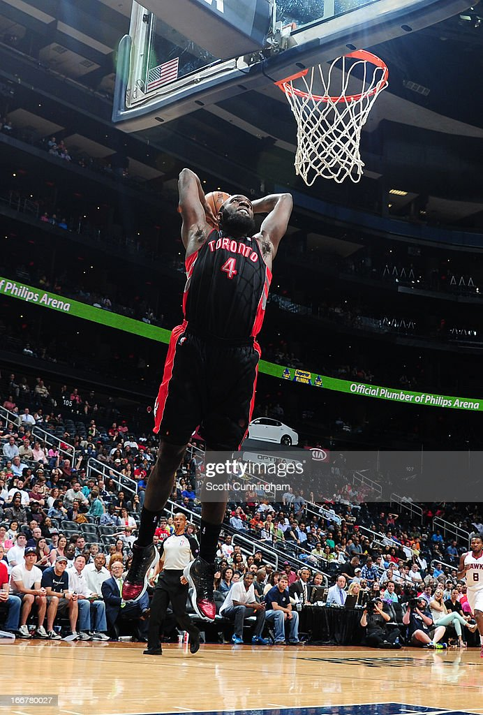 <a gi-track='captionPersonalityLinkClicked' href=/galleries/search?phrase=Quincy+Acy&family=editorial&specificpeople=5674079 ng-click='$event.stopPropagation()'>Quincy Acy</a> #4 of the Toronto Raptors dunks the ball against the Atlanta Hawks on April 16, 2013 at Philips Arena in Atlanta, Georgia.