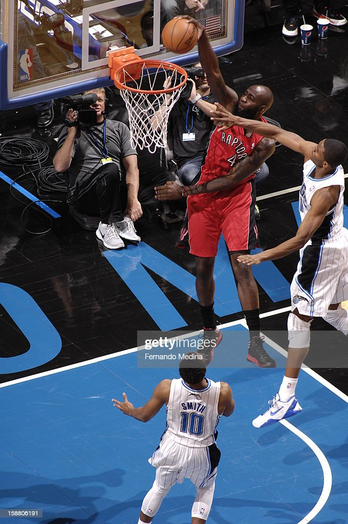 Quincy Acy #4 of the Toronto Raptors goes up for the dunk against the Orlando Magic during the game on December 29, 2012 at Amway Center in Orlando, Florida.