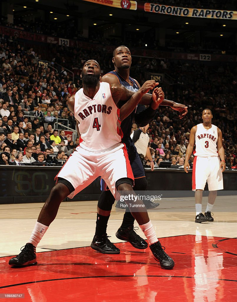 Quincy Acy #4 of the Toronto Raptors waits for the rebound against the Charlotte Bobcats during the game on January 11, 2013 at the Air Canada Centre in Toronto, Ontario, Canada.