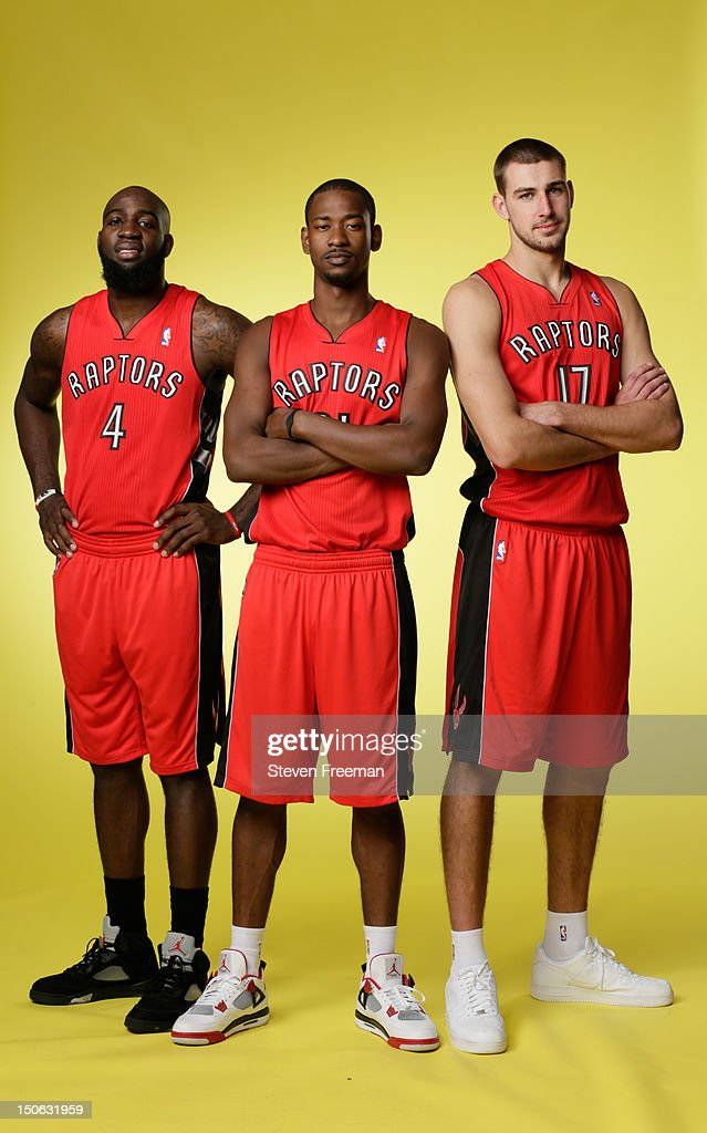 Quincy Acy #4, Terrence Ross #21 and Jonas Valanciunas #17 of the Toronto Raptors poses for a portrait during the 2012 NBA rookie photo shoot on August 21, 2012 at the MSG Training Facility in Tarrytown, New York.