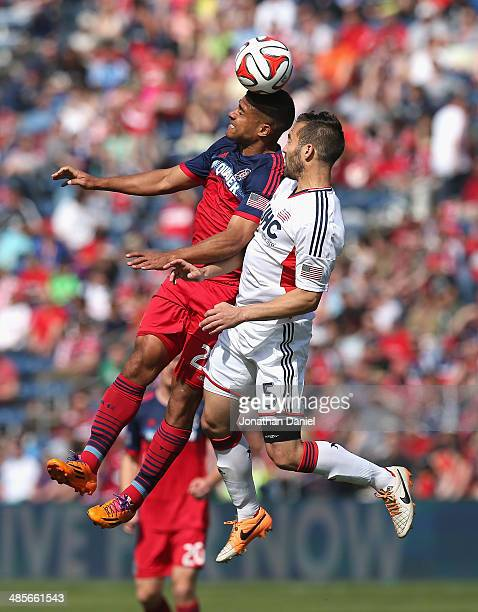 Quincy Amarikaw of the Chicago Fire heads the ball over AJ Soares of the New England Revolution during an MLS match at Toyota Park on April19 2014 in...