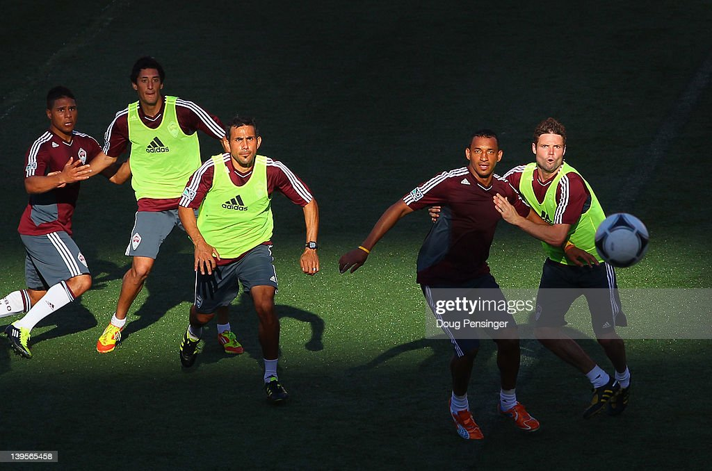 Quincy Amarikwa #12, Jaime Castrillon #23, Pablo Mastroeni #25, Tyrone Marshall #34 and Drew Moor #3 of the Colorado Rapids look to control of the ball during a training session at the Aloha Stadium on February 22, 2012 in Honolulu, Hawaii. The Rapids are preparing for the Hawaiian Islands Invitational Soccer Tournament.