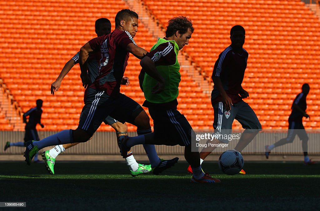 Quincy Amarikwa #12 of the Colorado Rapids and <a gi-track='captionPersonalityLinkClicked' href=/galleries/search?phrase=Brian+Mullan&family=editorial&specificpeople=241480 ng-click='$event.stopPropagation()'>Brian Mullan</a> #11 of the Colorado Rapids battle for control of the ball during a training session at the Aloha Stadium on February 22, 2012 in Honolulu, Hawaii. The Rapids are preparing for the Hawaiian Islands Invitational Soccer Tournament.