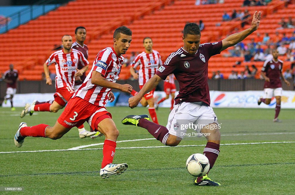 Quincy Amarikwa #12 of the Colorado Rapids takes a shot as Kristian Konstantinidis #3 of the Melbourne Heart FC follows the play during the Hawaiian Islands Invitational Soccer Tournament at the Aloha Stadium on February 25, 2012 in Honolulu, Hawaii. The Rapids defeated Heart FC 1-0 in the consolation game.