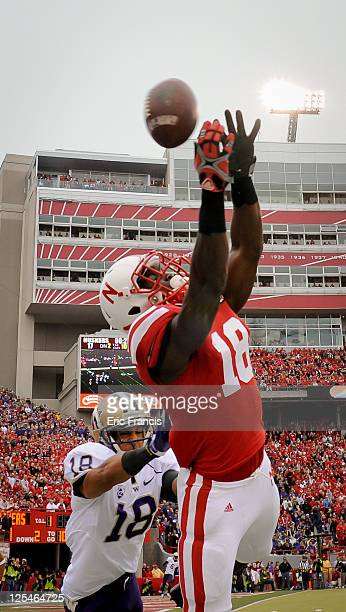 Quincy Enunwa of the Nebraska Cornhuskers reaches for a pass over Gregory Ducre of the Washington Huskies during their game at Memorial Stadium...
