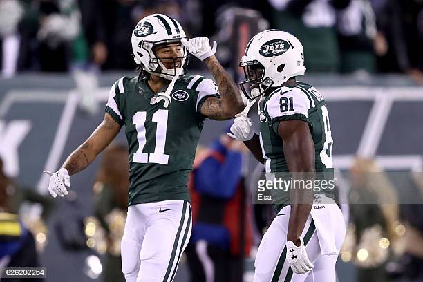 Quincy Enunwa of the New York Jets celebrates with Robby Anderson after scoring a 22 yard touchdown pass against the New England Patriots during the...