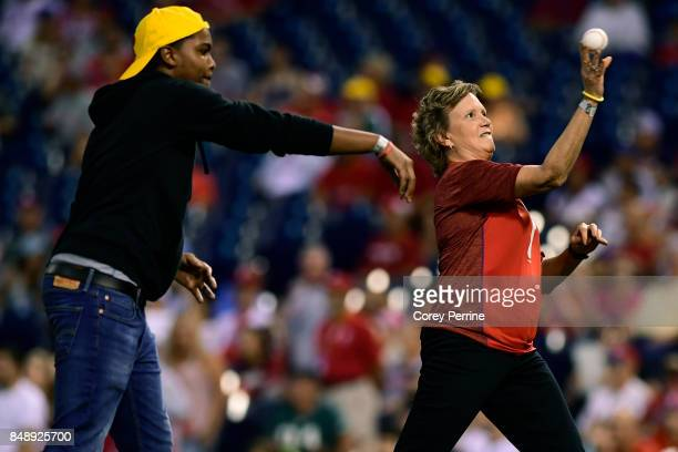 Quincy Harmon and Dyanne Bunnell throw out ceremonial first pitches in honor of Pediatric Cancer Awareness Night before the game between the...