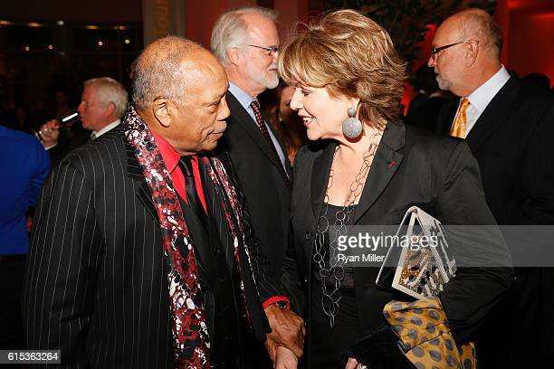 Quincy Jones and Renée Fleming talk during The J Paul Getty Medal Dinner on October 17 2016 in Los Angeles California