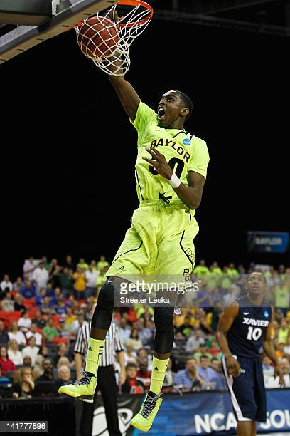 Quincy Miller of the Baylor Bears dunks against the Xavier Musketeers in the first half during the 2012 NCAA Men's Basketball South Regional...