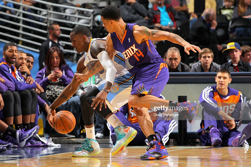 Quincy Miller #30 of the Denver Nuggets and <a gi-track='captionPersonalityLinkClicked' href=/galleries/search?phrase=Gerald+Green&family=editorial&specificpeople=644655 ng-click='$event.stopPropagation()'>Gerald Green</a> #14 of the Phoenix Suns vie for control of a loose ball during preseason action at Pepsi Center on October 23, 2013 in Denver, Colorado. The Suns defeated the Nuggets 98-79.