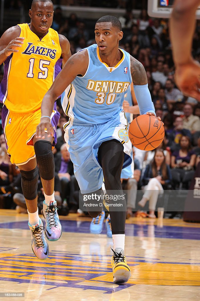 Quincy Miller #30 of the Denver Nuggets brings the ball up court during a game against the Los Angeles Lakers at STAPLES Center on October 10, 2013 at in Los Angeles, California.