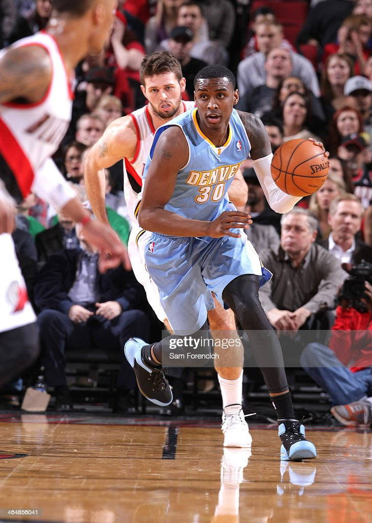Quincy Miller #30 of the Denver Nuggets dribbles the ball up court against the Portland Trail Blazers on January 23, 2014 at the Moda Center Arena in Portland, Oregon.