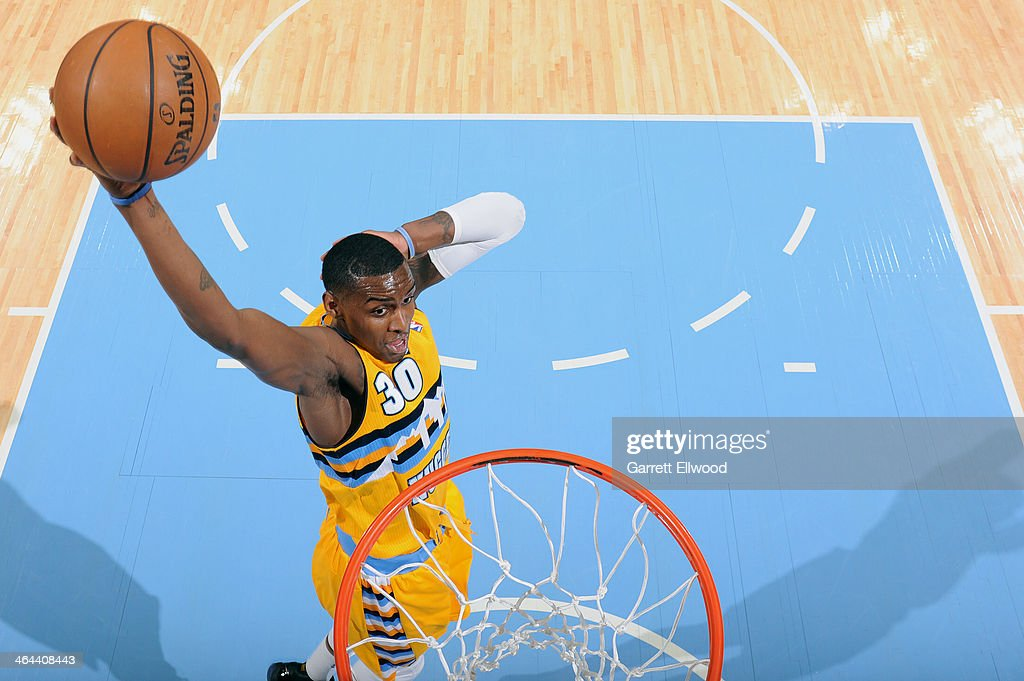 Quincy Miller #30 of the Denver Nuggets dunking during a game against the Oklahoma City Thunder on January 9, 2014 at the Pepsi Center in Denver, Colorado.