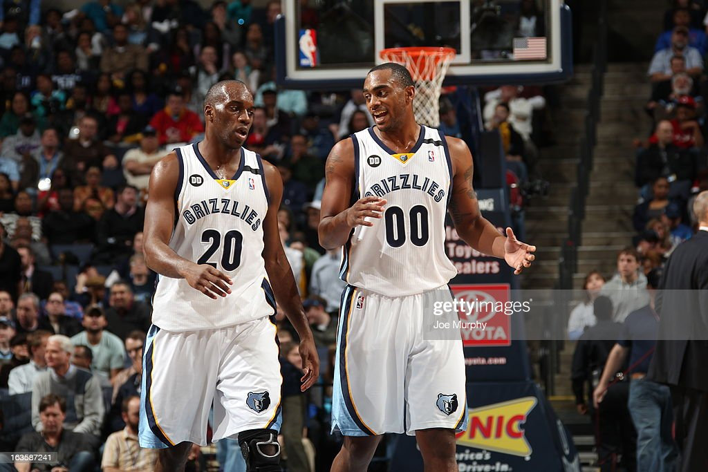 <a gi-track='captionPersonalityLinkClicked' href=/galleries/search?phrase=Quincy+Pondexter&family=editorial&specificpeople=4176540 ng-click='$event.stopPropagation()'>Quincy Pondexter</a> #20 and <a gi-track='captionPersonalityLinkClicked' href=/galleries/search?phrase=Darrell+Arthur&family=editorial&specificpeople=4102032 ng-click='$event.stopPropagation()'>Darrell Arthur</a> #00 of the Memphis Grizzlies share a word during a break in play against the Dallas Mavericks on February 27, 2013 at FedExForum in Memphis, Tennessee.