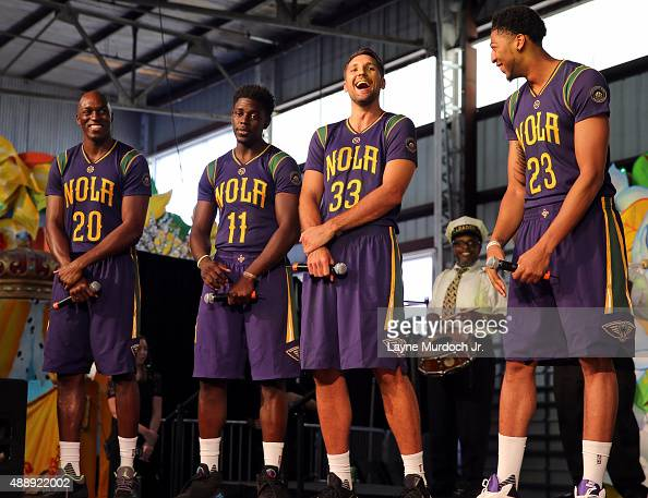Quincy Pondexter Jrue Holiday Ryan Anderson and Anthony Davis of the New Orleans Pelicans unveil their Mardi Grasthemed Pride uniforms to be worn...