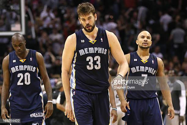 Quincy Pondexter Marc Gasol and Jerryd Bayless of the Memphis Grizzlies react dejected after they lost in overtime 9389 against the San Antonio Spurs...