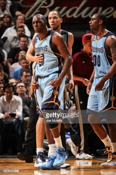 Quincy Pondexter of the Memphis Grizzlies celebrates with teammate Tayshaun Prince after drawing a foul while making a threepointer against the Miami...