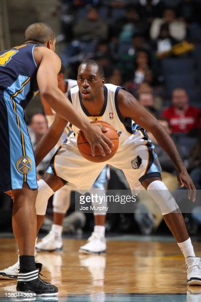 Quincy Pondexter of the Memphis Grizzlies defends against Andre Miller of the Denver Nuggets on January 31 2012 at FedExForum in Memphis Tennessee...