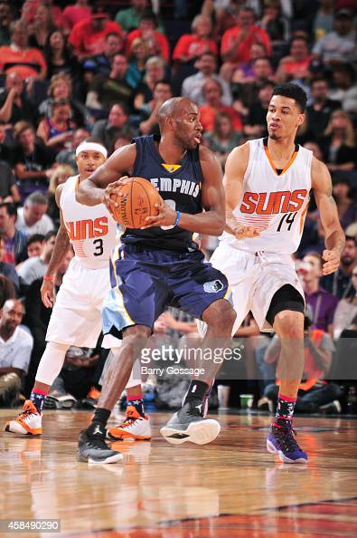 Quincy Pondexter of the Memphis Grizzlies defends the ball against the Phoenix Suns during the game on November 5 2014 at US Airways Center in...