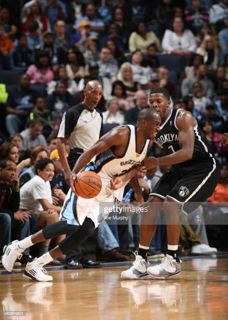Quincy Pondexter of the Memphis Grizzlies dribbles against Joe Johnson of the Brooklyn Nets on November 30 2013 at FedExForum in Memphis Tennessee...