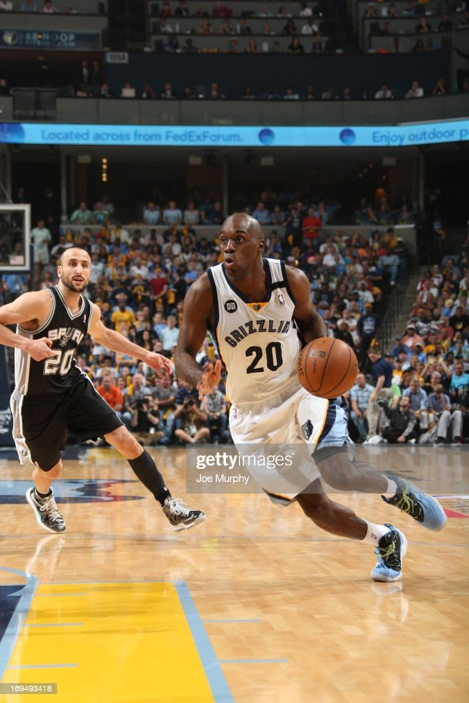Quincy Pondexter of the Memphis Grizzlies drives against Manu Ginobili of the San Antonio Spurs during Game Three of the Western Conference Finals...
