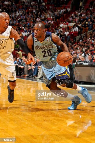 Quincy Pondexter of the Memphis Grizzlies drives against Ray Allen of the Miami Heat on March 1 2013 at American Airlines Arena in Miami Florida NOTE...