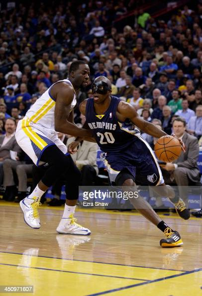 Quincy Pondexter of the Memphis Grizzlies drives on Draymond Green of the Golden State Warriors at ORACLE Arena on November 20 2013 in Oakland...