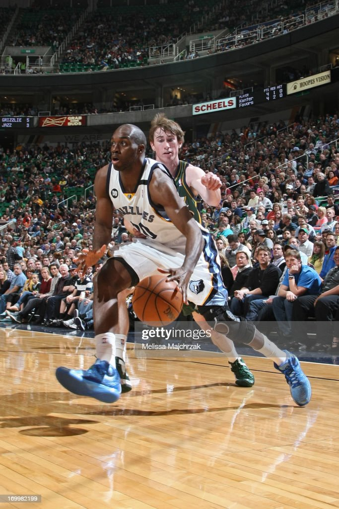 Quincy Pondexter of the Memphis Grizzlies drives to the basket against Gordon Hayward of the Utah Jazz at Energy Solutions Arena on March 16 2013 in...