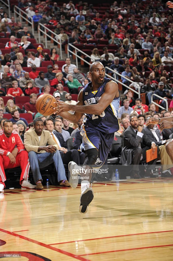 <a gi-track='captionPersonalityLinkClicked' href=/galleries/search?phrase=Quincy+Pondexter&family=editorial&specificpeople=4176540 ng-click='$event.stopPropagation()'>Quincy Pondexter</a> #20 of the Memphis Grizzlies drives to the basket against the Houston Rockets on December 22, 2012 at the Toyota Center in Houston, Texas.