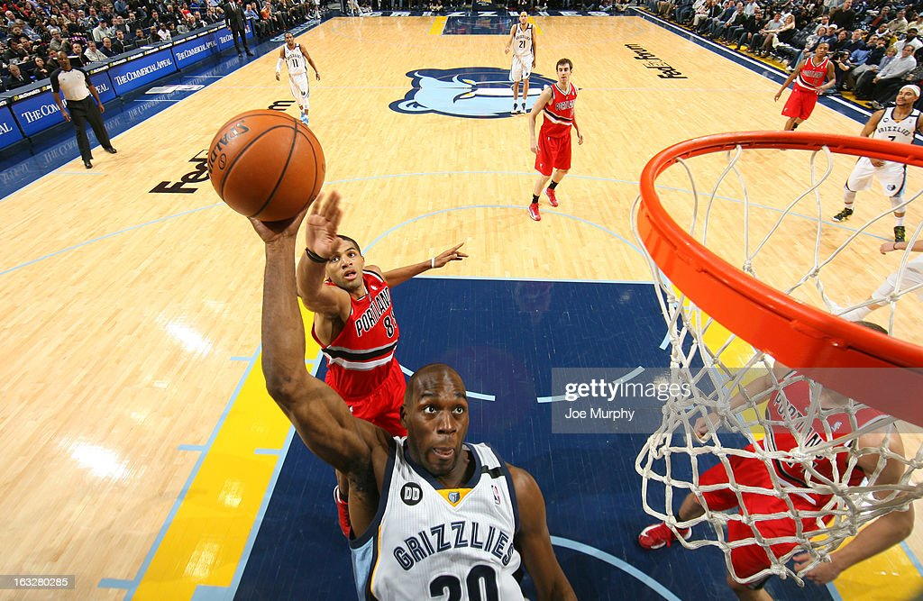 Quincy Pondexter #20 of the Memphis Grizzlies dunks against Nicolas Batum #88 of the Portland Trail Blazers on March 6, 2013 at FedExForum in Memphis, Tennessee.