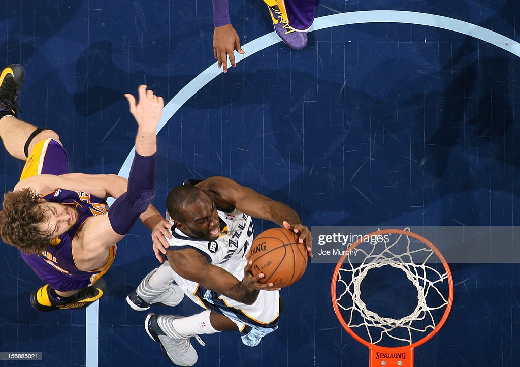 Quincy Pondexter #20 of the Memphis Grizzlies dunks against Pau Gasol #16 of the Los Angeles Lakers on November 23, 2012 at FedExForum in Memphis, Tennessee.