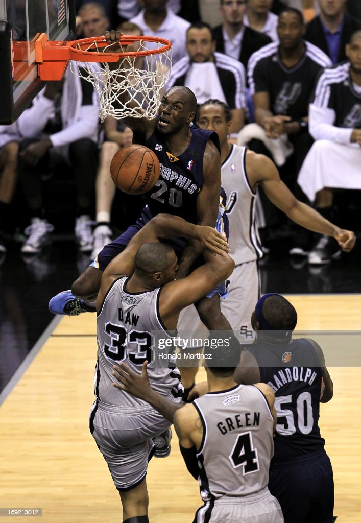 <a gi-track='captionPersonalityLinkClicked' href=/galleries/search?phrase=Quincy+Pondexter&family=editorial&specificpeople=4176540 ng-click='$event.stopPropagation()'>Quincy Pondexter</a> #20 of the Memphis Grizzlies dunks in the fourth quarter against <a gi-track='captionPersonalityLinkClicked' href=/galleries/search?phrase=Boris+Diaw&family=editorial&specificpeople=201505 ng-click='$event.stopPropagation()'>Boris Diaw</a> #33 of the San Antonio Spurs during Game Two of the Western Conference Finals of the 2013 NBA Playoffs at AT&T Center on May 21, 2013 in San Antonio, Texas.