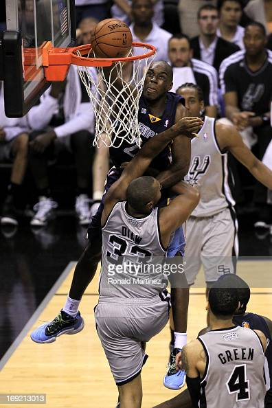 Quincy Pondexter of the Memphis Grizzlies dunks in the fourth quarter against Boris Diaw of the San Antonio Spurs during Game Two of the Western...