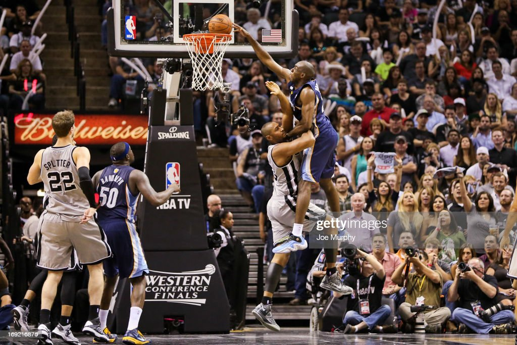 <a gi-track='captionPersonalityLinkClicked' href=/galleries/search?phrase=Quincy+Pondexter&family=editorial&specificpeople=4176540 ng-click='$event.stopPropagation()'>Quincy Pondexter</a> #20 of the Memphis Grizzlies dunks late in the fourth quarter against <a gi-track='captionPersonalityLinkClicked' href=/galleries/search?phrase=Boris+Diaw&family=editorial&specificpeople=201505 ng-click='$event.stopPropagation()'>Boris Diaw</a> #33 of the San Antonio Spurs in Game Two of the Western Conference Finals during the 2013 NBA Playoffs on May 21, 2013 at the AT&T Center in San Antonio, Texas.